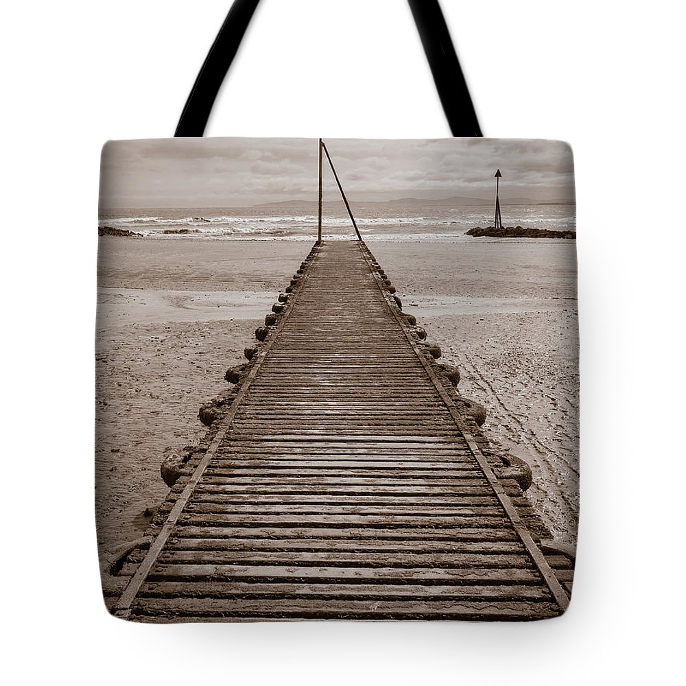 Beach Tote Bag featuring the photograph Wooden Slipway Rhos On Sea by Mark Llewellyn