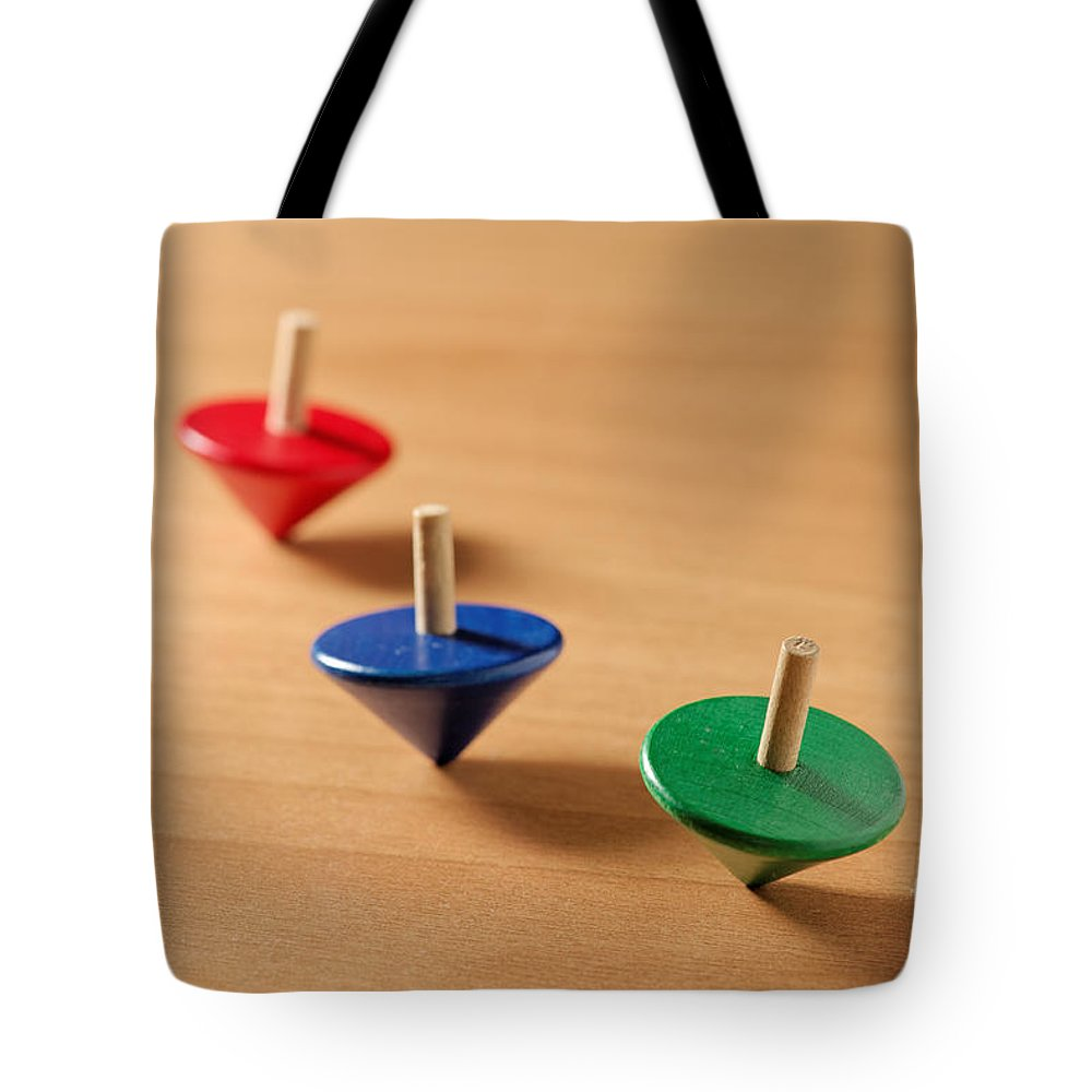 Top Tote Bag featuring the photograph Wooden Tops by Grigorios Moraitis