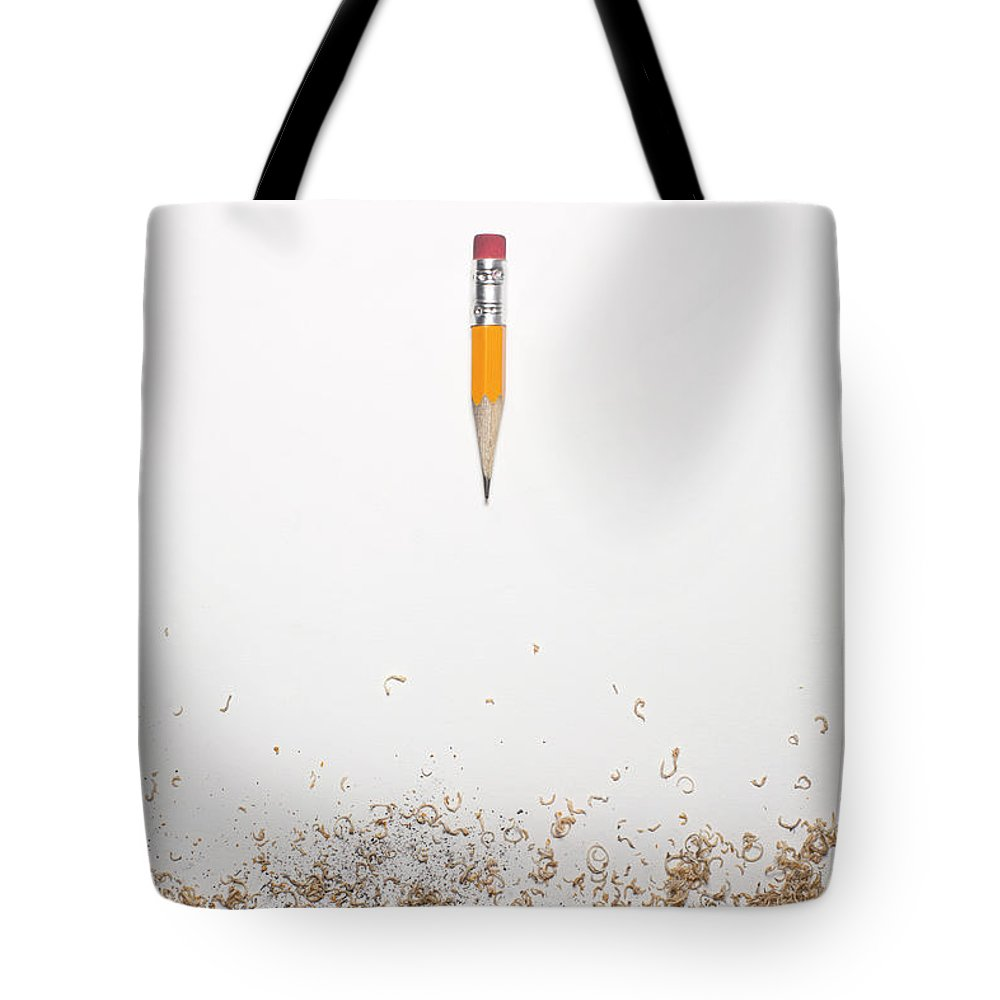 White Background Tote Bag featuring the photograph Worn Down Pencil With Shaving by Chris Parsons