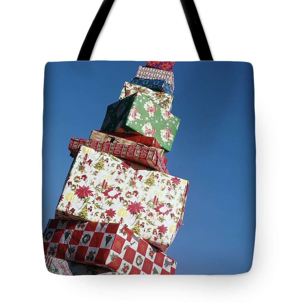 Photography Tote Bag featuring the photograph Wrapped Christmas Present Stacked by Vintage Images