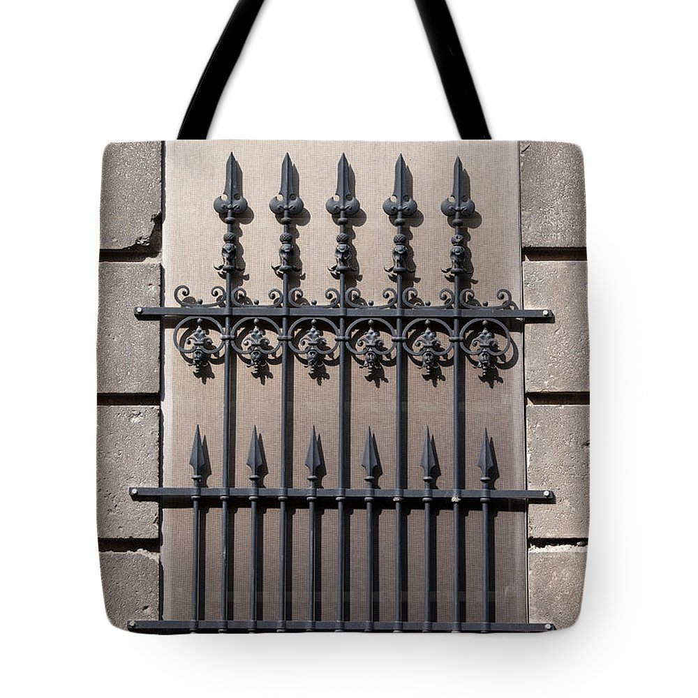 Window Tote Bag featuring the photograph Wrought Iron Window Grille by Artur Bogacki