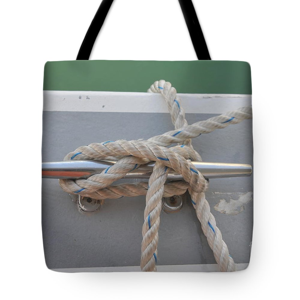Yacht Tote Bag featuring the photograph Yacht Secured To A Jetty by Shay Levy