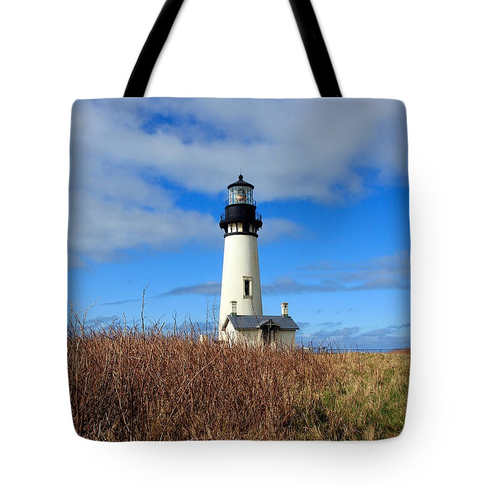 Yaquina Bay Lighthouse Tote Bag featuring the photograph Yaquina Bay Lighthouse In Oregon by Athena Mckinzie