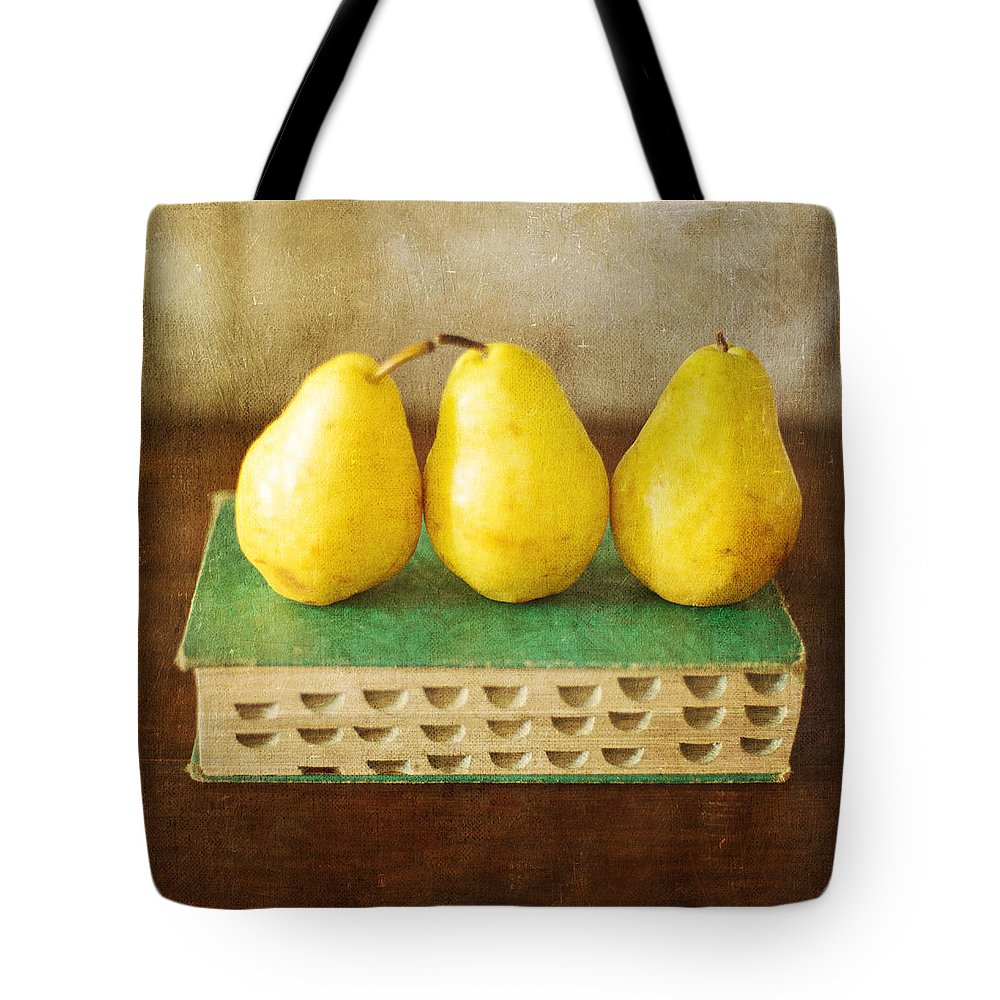Yellow Pears Tote Bag featuring the photograph Yellow Pears And Vintage Green Book Still Life by Renee Hong