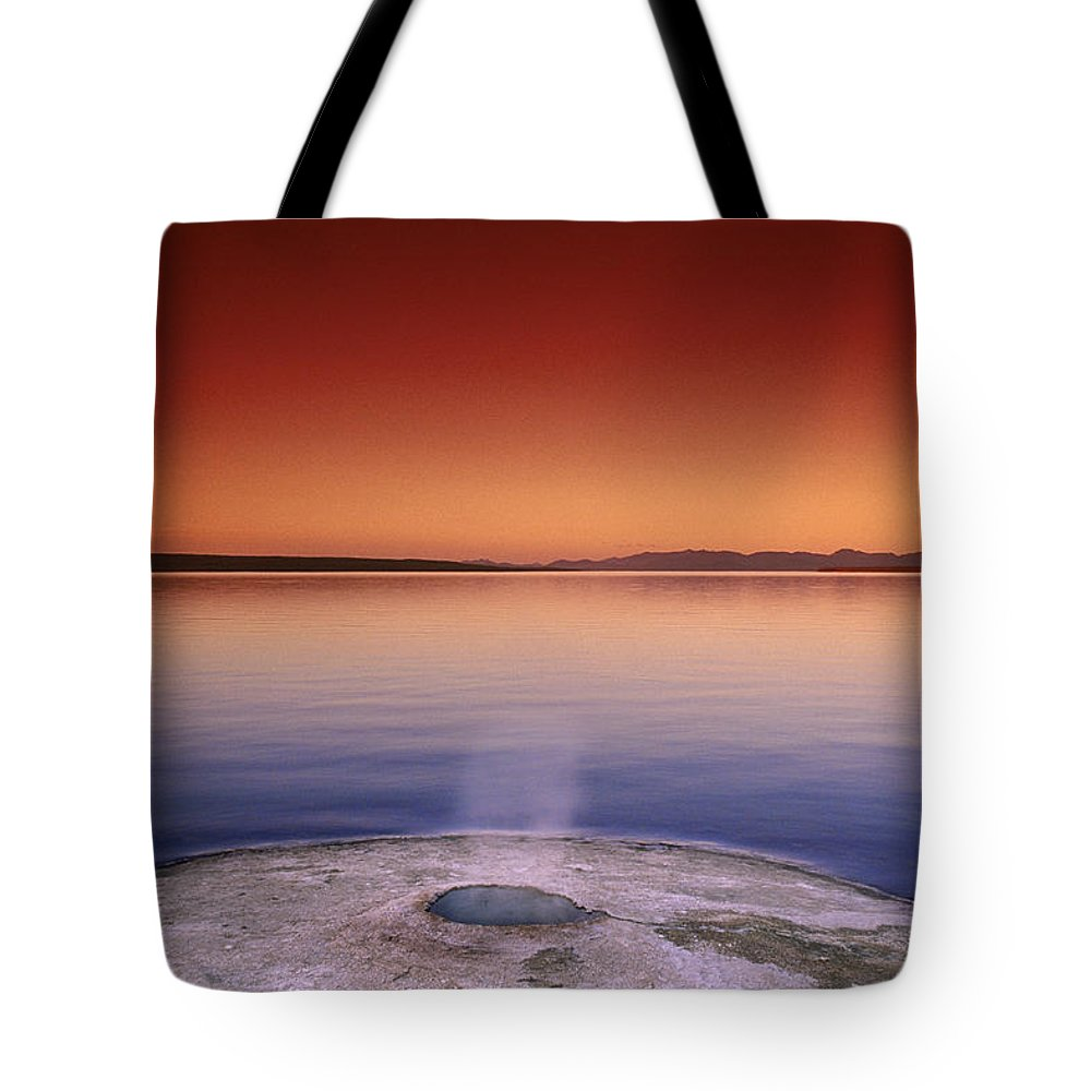 Yellowstone Tote Bag featuring the photograph Yellowstone Lake And Geyser by Rich Franco