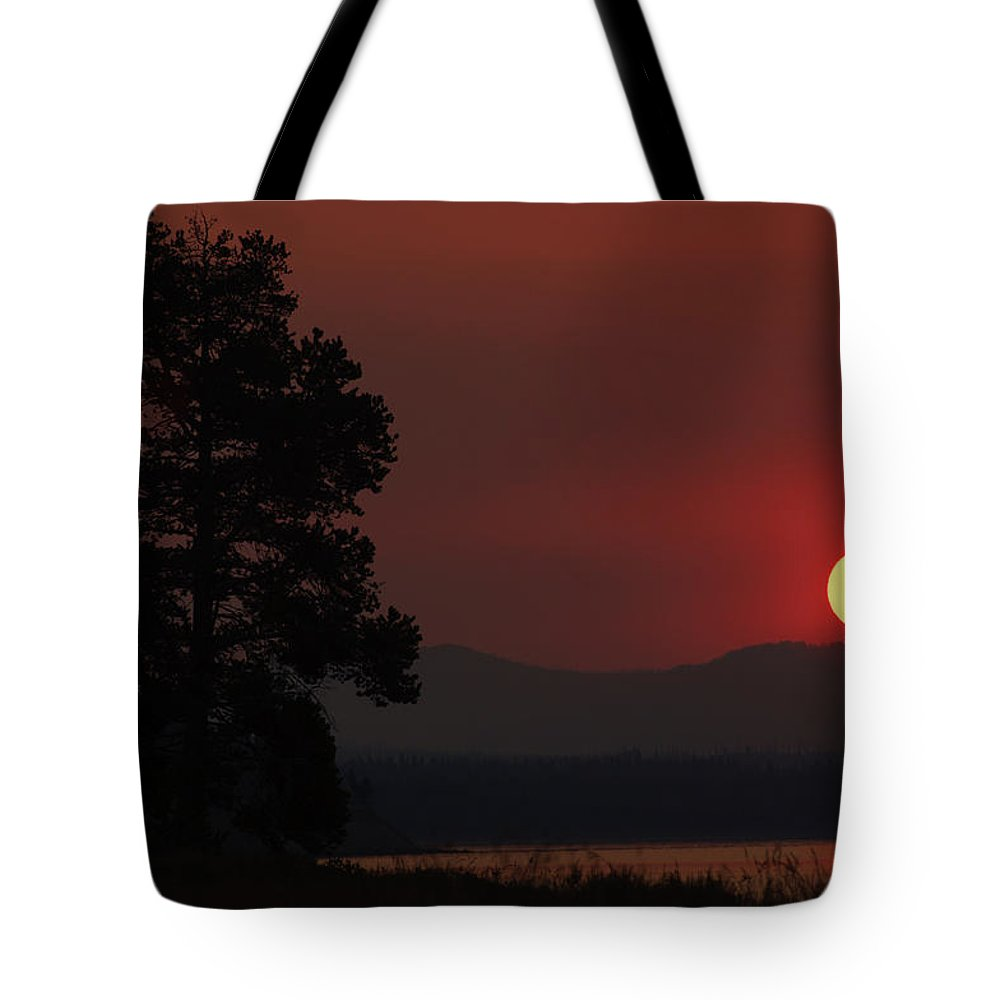 Smoke Tote Bag featuring the photograph Yellowstone Lake Sunrise On Smoky Day by Bruce Gourley