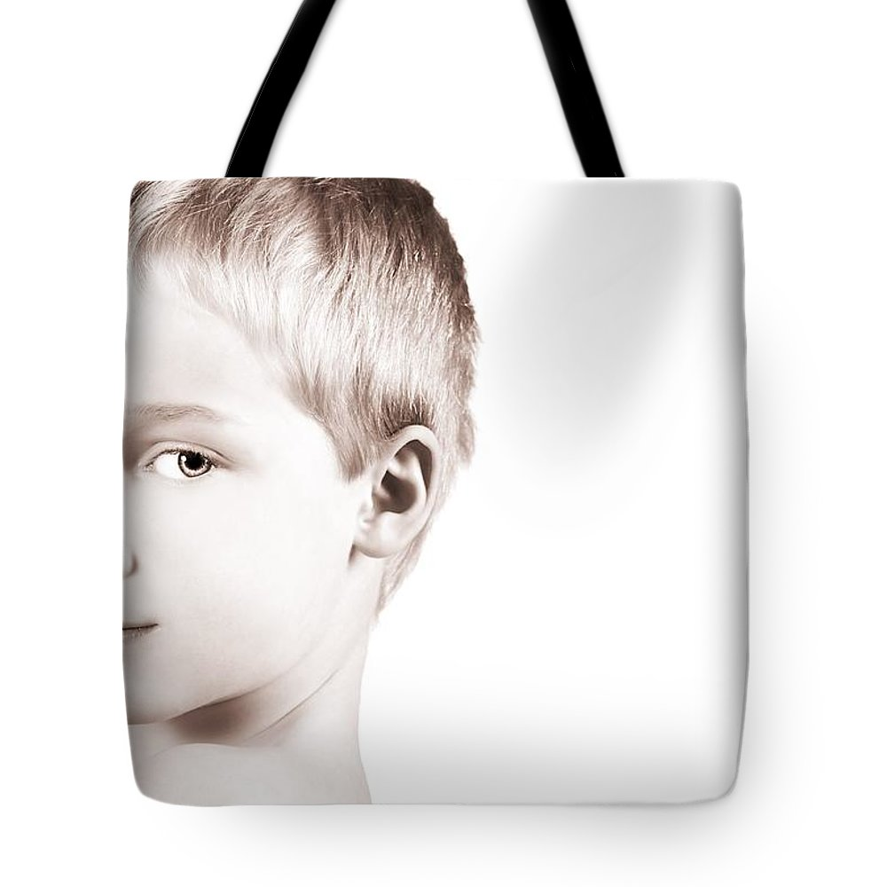 Children Tote Bag featuring the photograph Young Boy by Chris and Kate Knorr