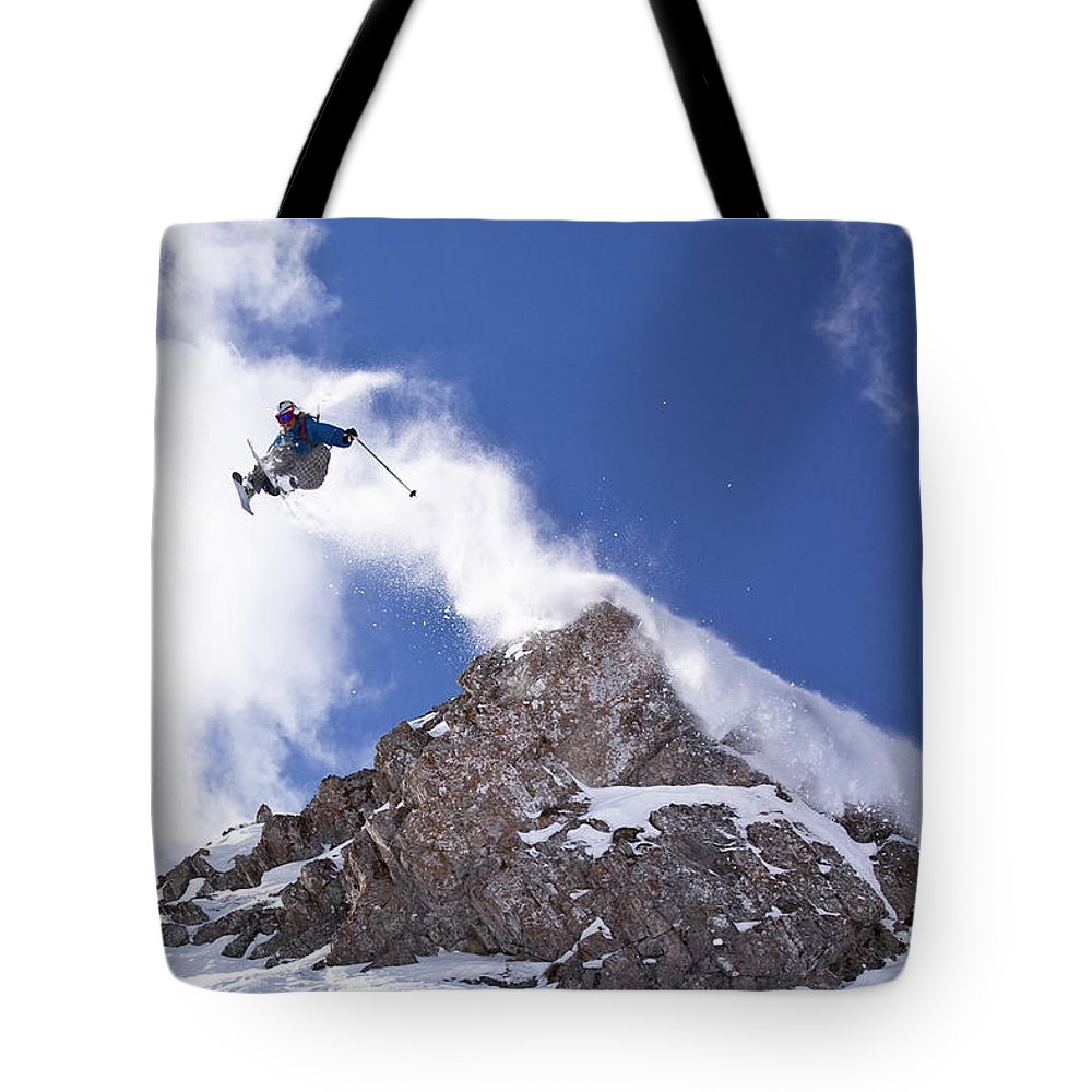 Action Tote Bag featuring the photograph Young Man Catches Huge Air While by Henry Georgi