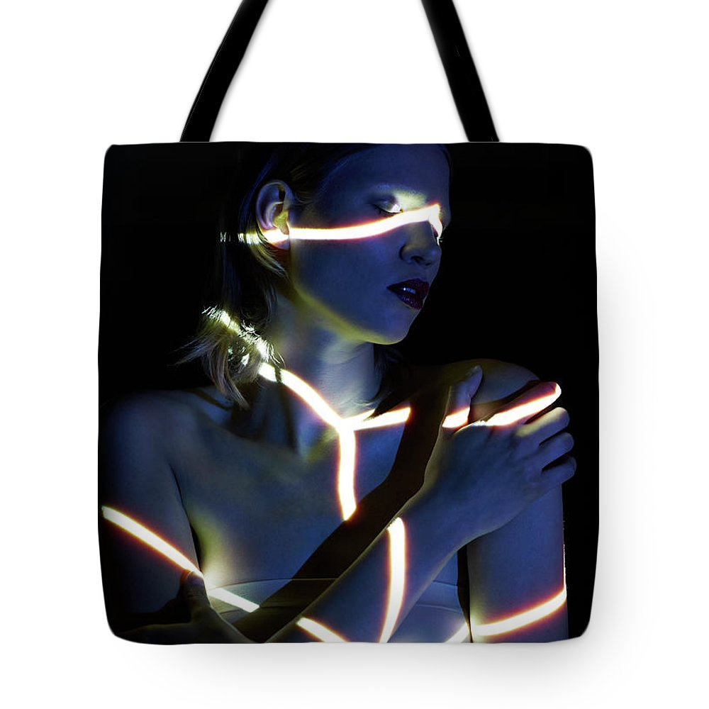 People Tote Bag featuring the photograph Young Woman Dimly Lit With Closed Eyes by Mads Perch