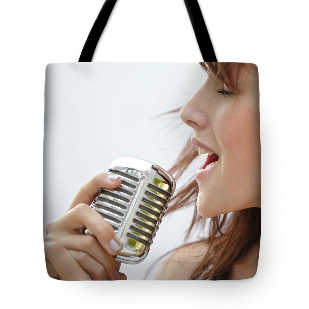 People Tote Bag featuring the photograph Young Woman Singing Into A Retro by Darren Robb