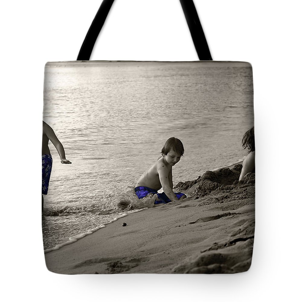 Boys Tote Bag featuring the photograph Youth At The Beach by Madeline Ellis