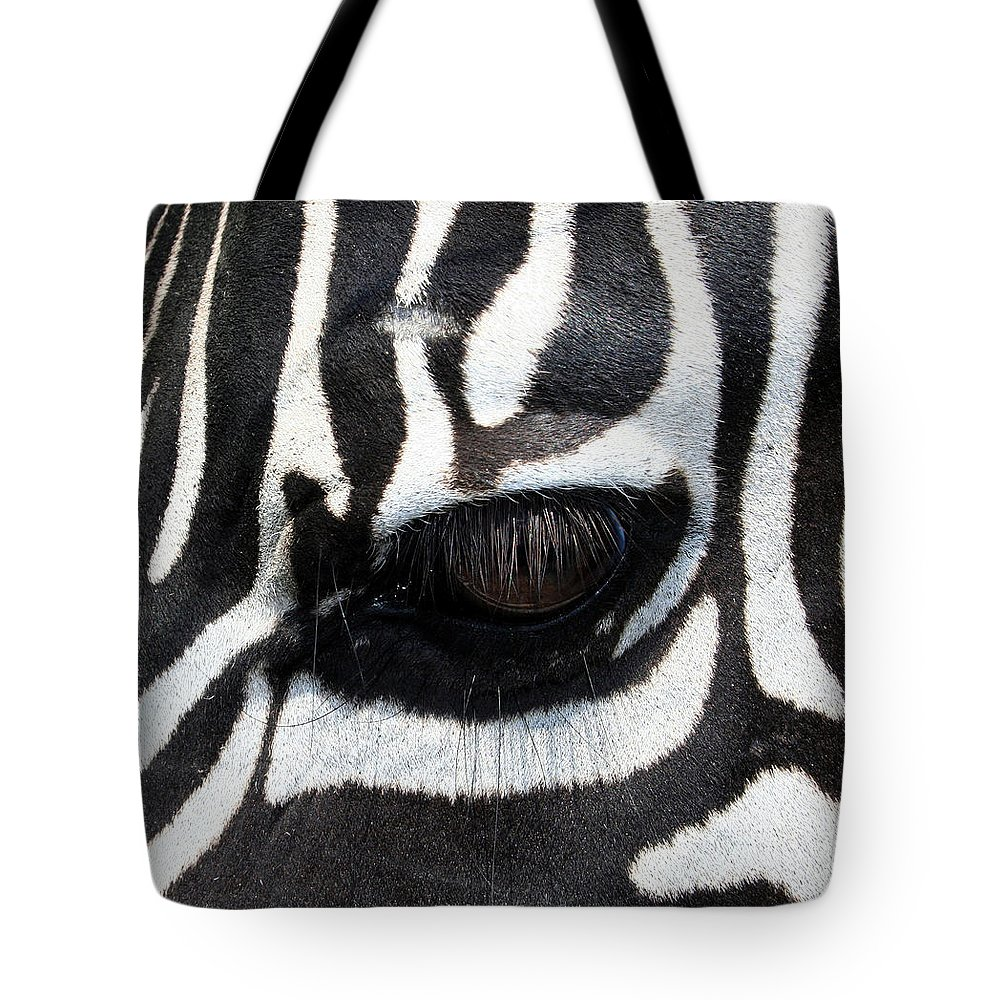 Zebra Tote Bag featuring the photograph Zebra Eye by Linda Sannuti