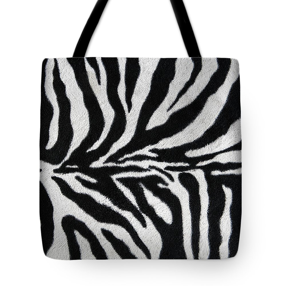 Animal Skin Tote Bag featuring the photograph Zebra Textile Background by Narvikk