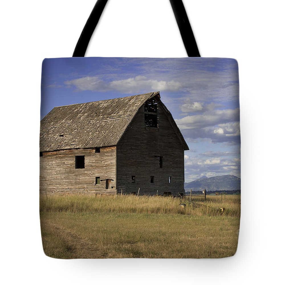 Big Sky Tote Bag featuring the photograph Old Big Sky Barn by Sandra Bronstein