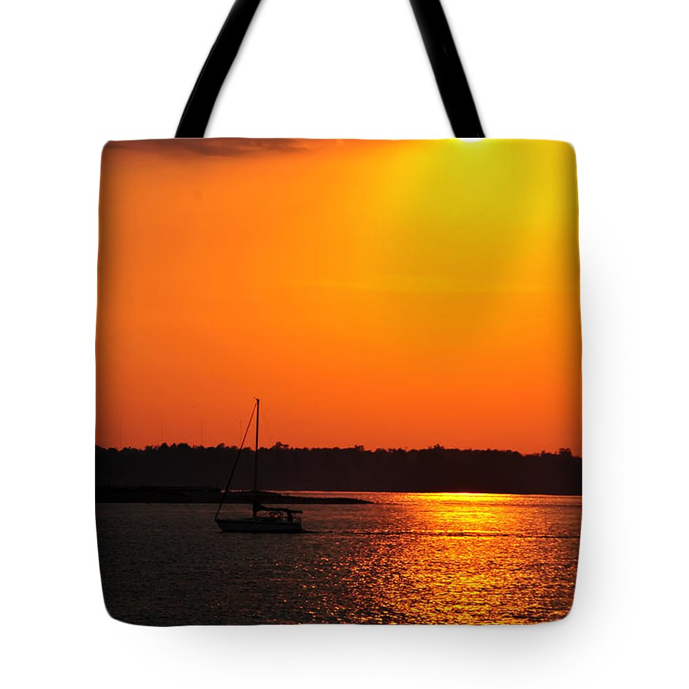 Tote Bag featuring the photograph 0001 Set Adrift by Michael Frank Jr
