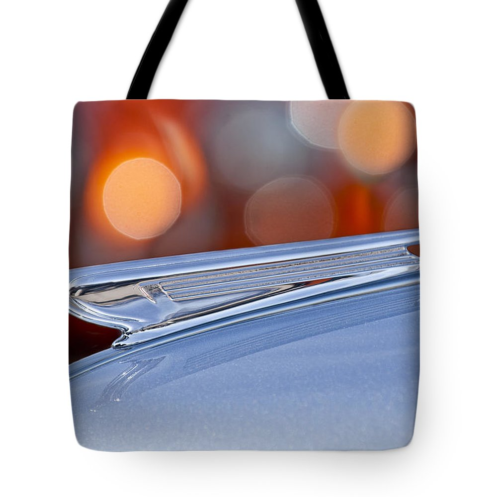 1938 Chevrolet Tote Bag featuring the photograph 1938 Chevrolet Hood Ornament by Jill Reger