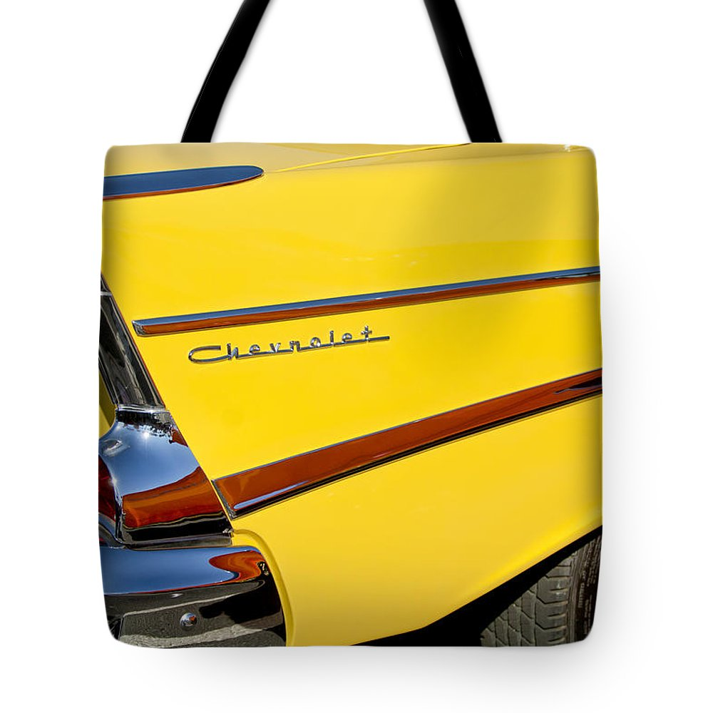 1957 Chevrolet Tote Bag featuring the photograph 1957 Chevrolet Taillight by Jill Reger