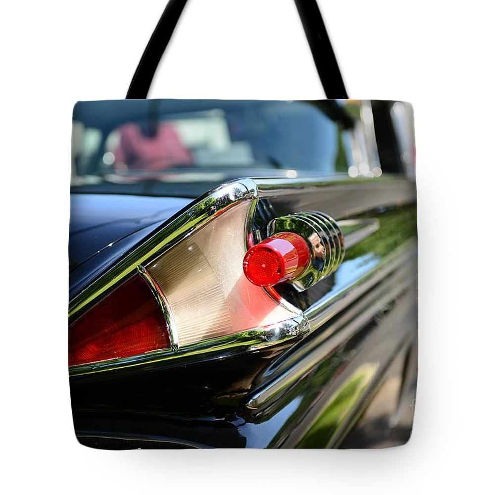 1958 Mercury Park Lane Tail Light Tote Bag featuring the photograph 1958 Mercury Park Lane Tail Light by Paul Ward