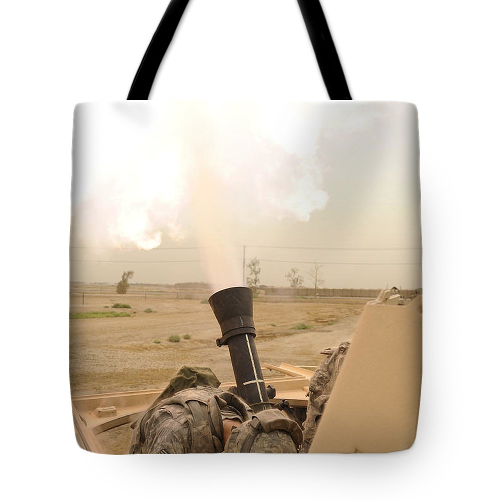 Iraq Tote Bag featuring the photograph A M120 Mortar System Is Fired by Stocktrek Images