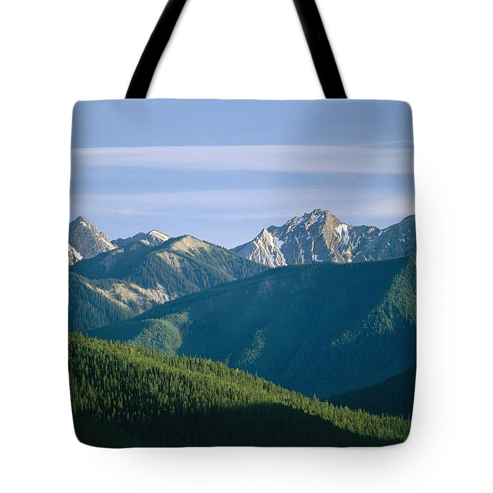 North America Tote Bag featuring the photograph A Scenic View Of The Rocky Mountains by Michael Melford