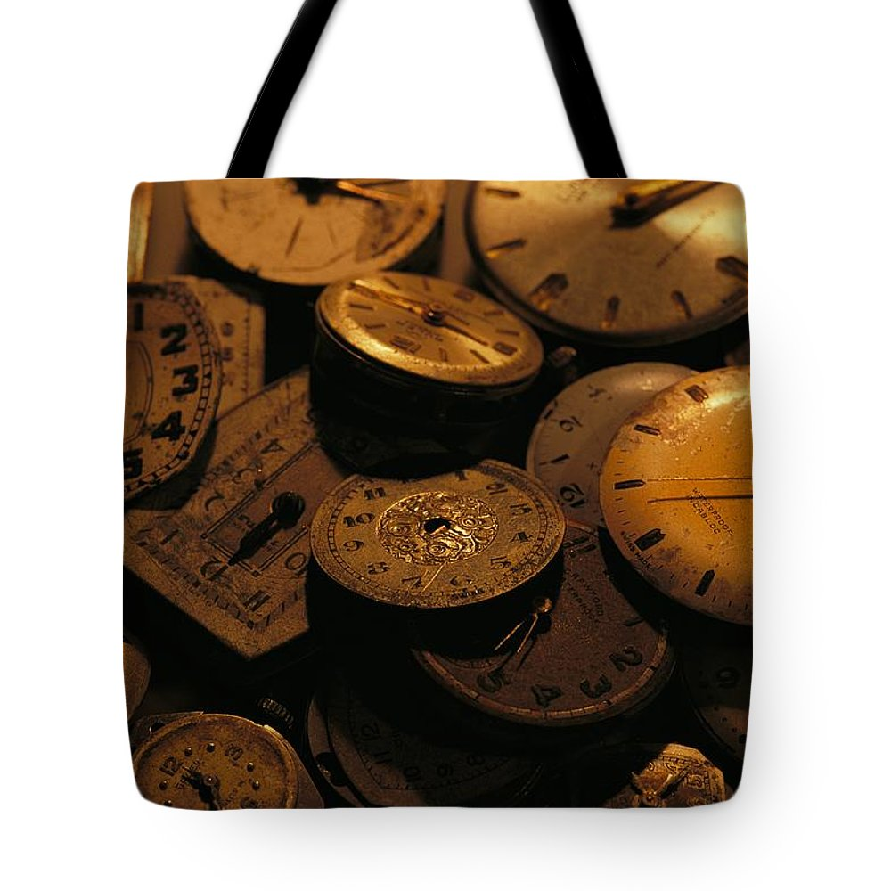 North America Tote Bag featuring the photograph A Still Life Of Old Watch Faces by Joel Sartore
