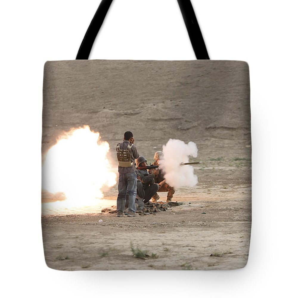 Operation Enduring Freedom Tote Bag featuring the photograph An Afghan Police Studen Fires by Terry Moore