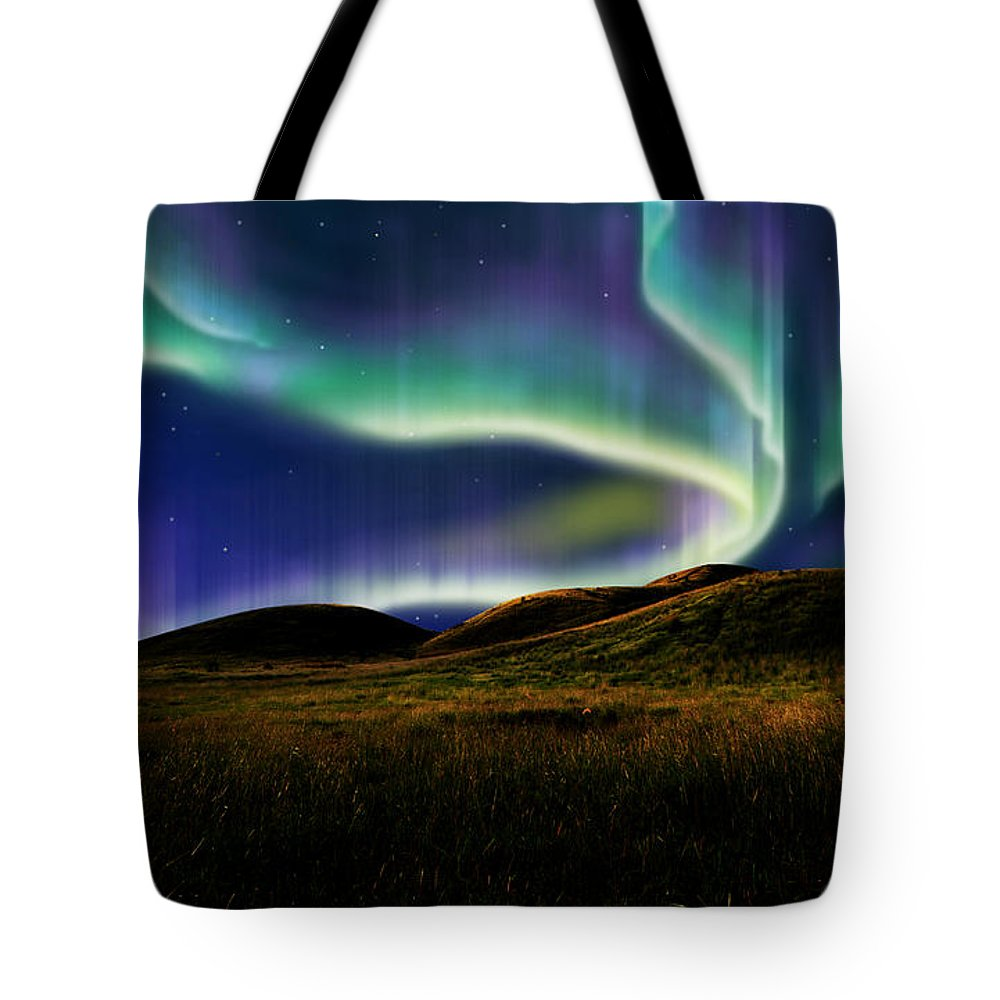 Above Tote Bag featuring the mixed media Aurora On Field by Atiketta Sangasaeng