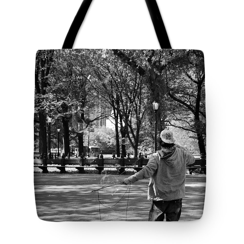 Black And White Tote Bag featuring the photograph Bubble Boy Of Central Park In Black And White by Rob Hans