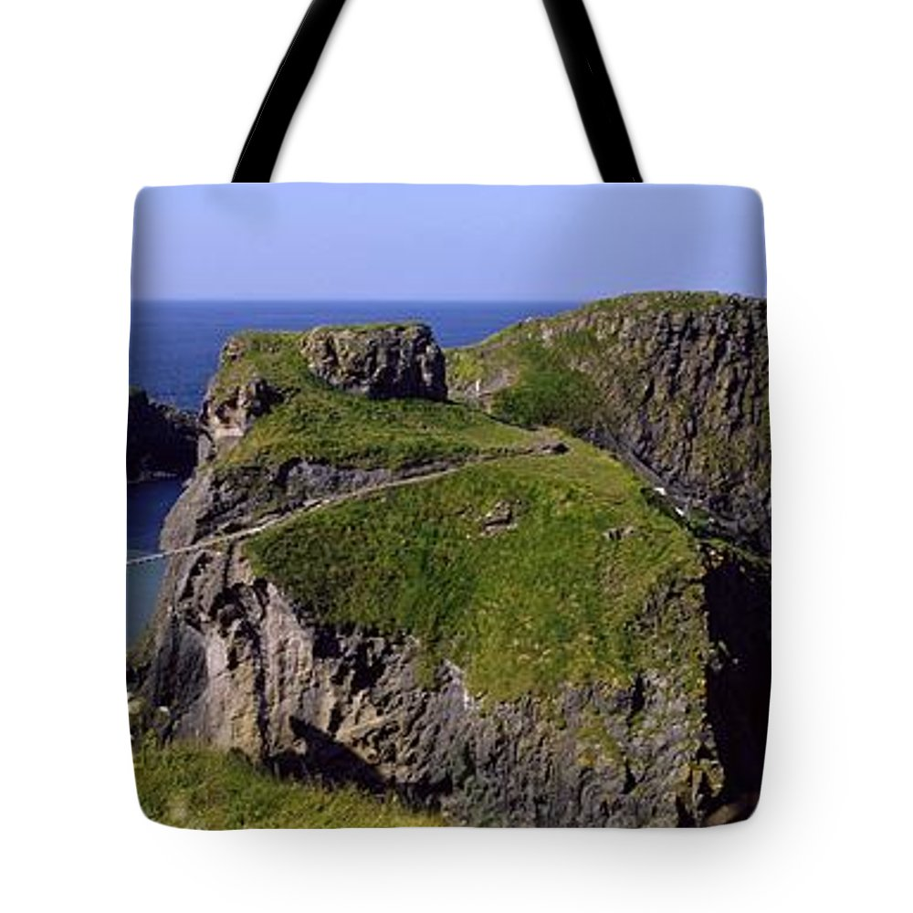 Beauty In Nature Tote Bag featuring the photograph Carrick-a-rede Rope Bridge, Co. Antrim by The Irish Image Collection