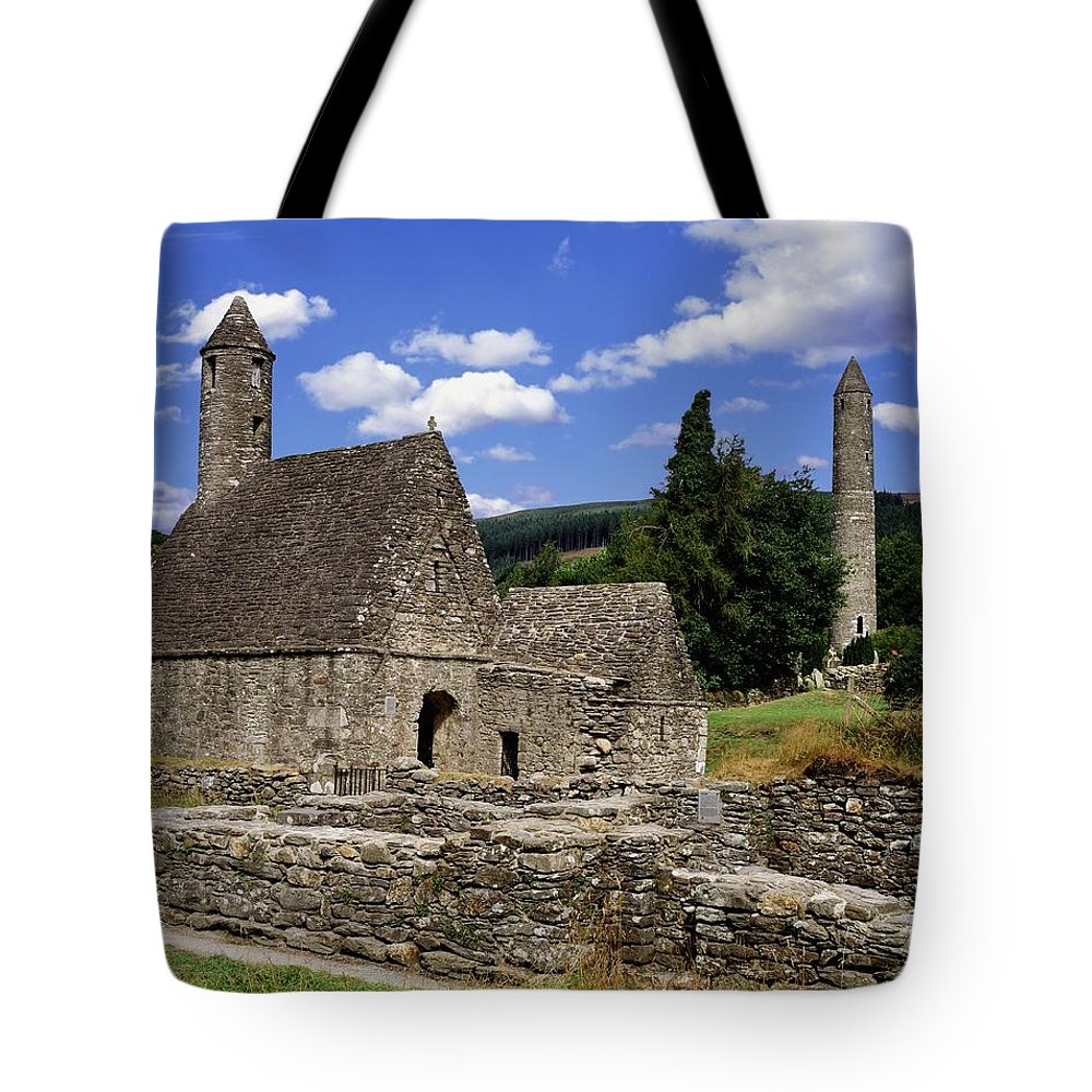 Architectural Exteriors Tote Bag featuring the photograph Chapel Of Saint Kevin At Glendalough by The Irish Image Collection