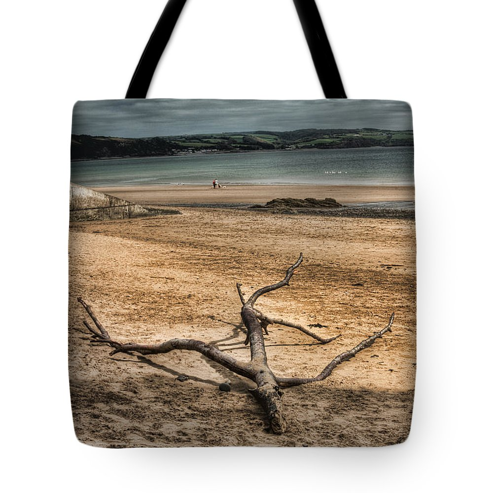 Driftwood Tote Bag featuring the photograph Driftwood 2 by Steve Purnell