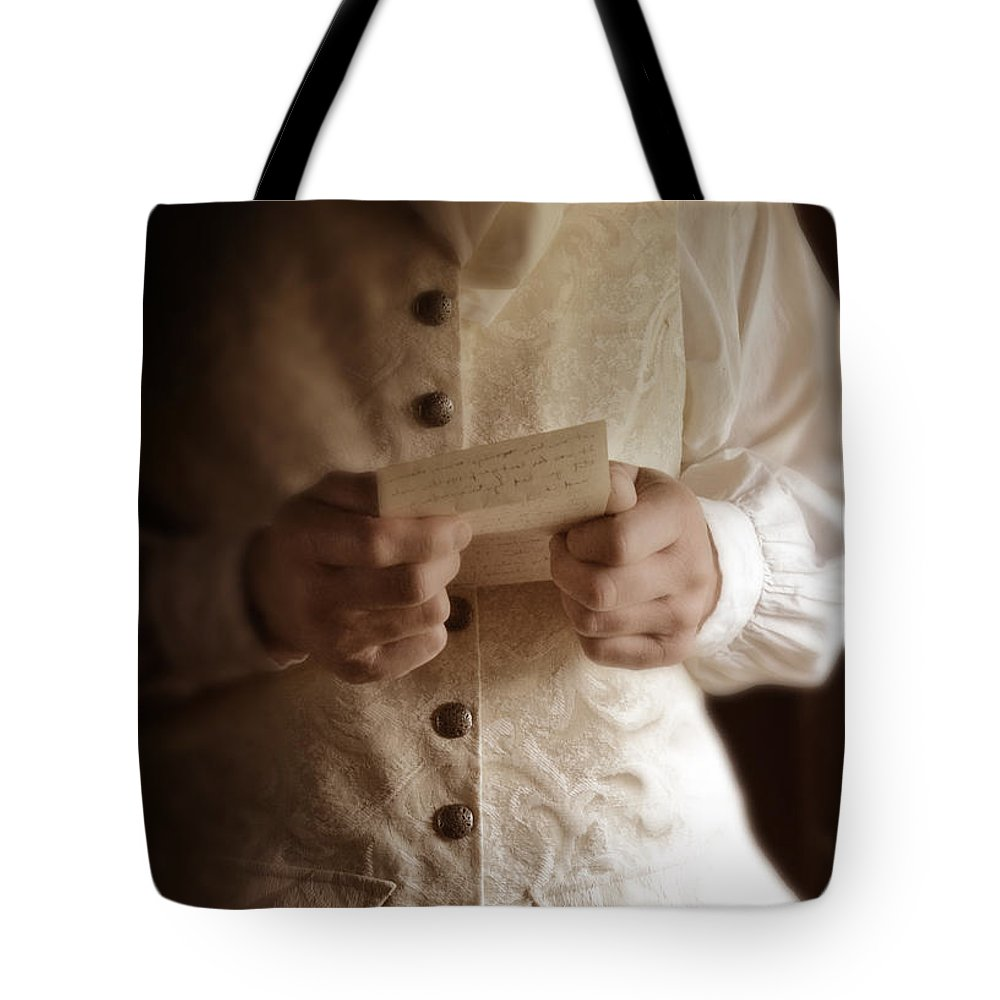 Gentleman Tote Bag featuring the photograph Gentleman In Vintage Clothing Reading A Letter by Jill Battaglia