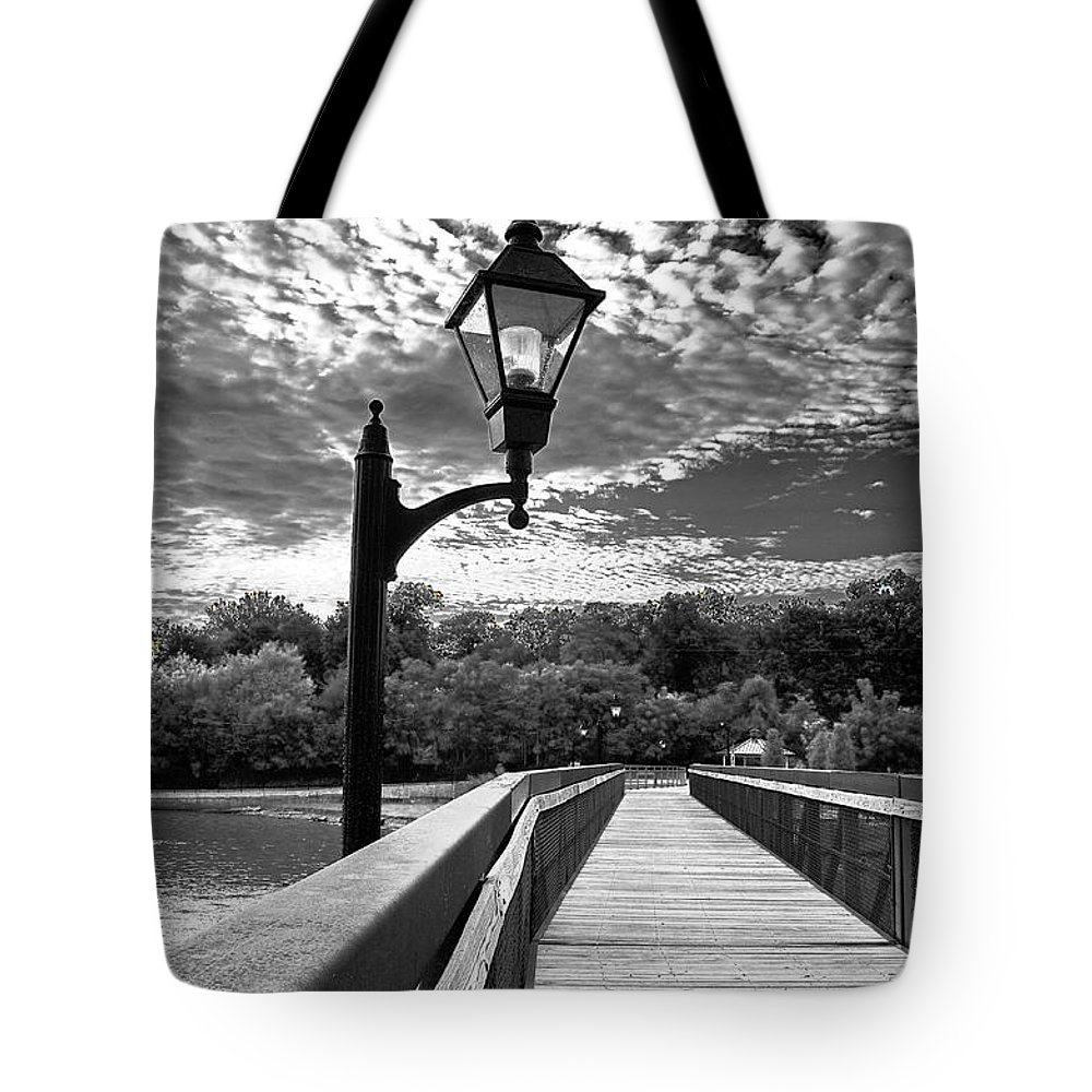 Black And White Photography Tote Bag featuring the photograph Guiding Light by Sue Stefanowicz