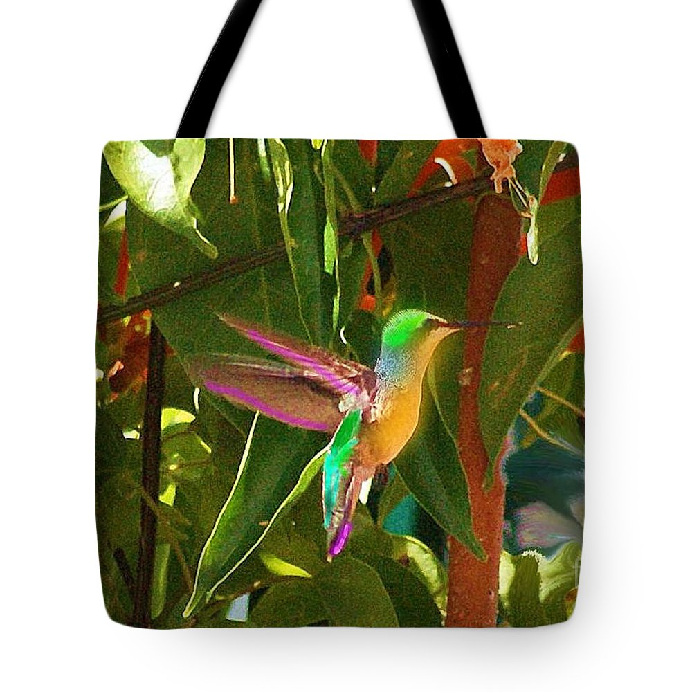 Humming Tote Bag featuring the photograph Humming Bird On Orange Flowers by John Kolenberg