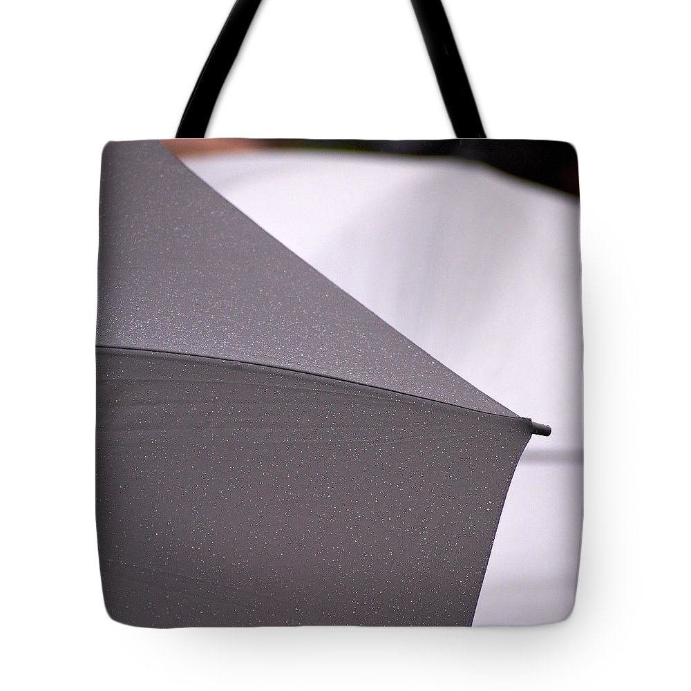 2012 Tote Bag featuring the photograph in Rain by Jouko Lehto