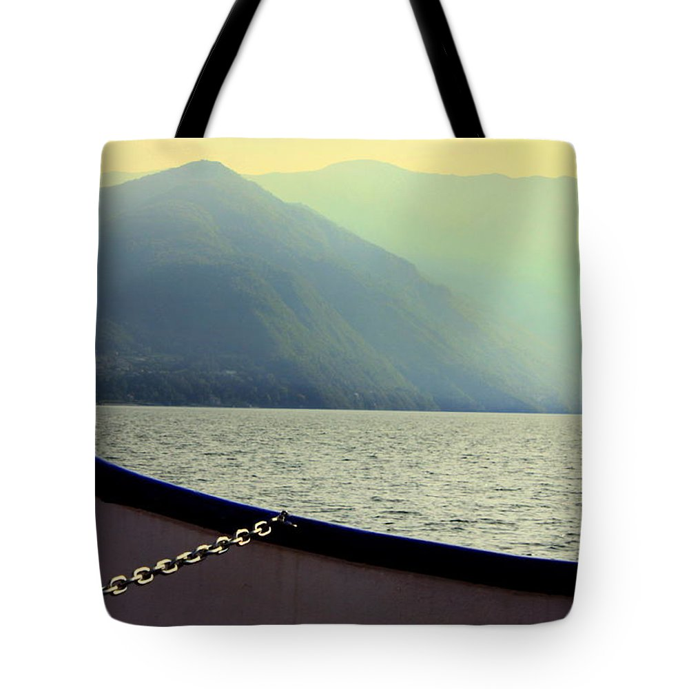 Haze Tote Bag featuring the photograph Lake Of Como by Valentino Visentini