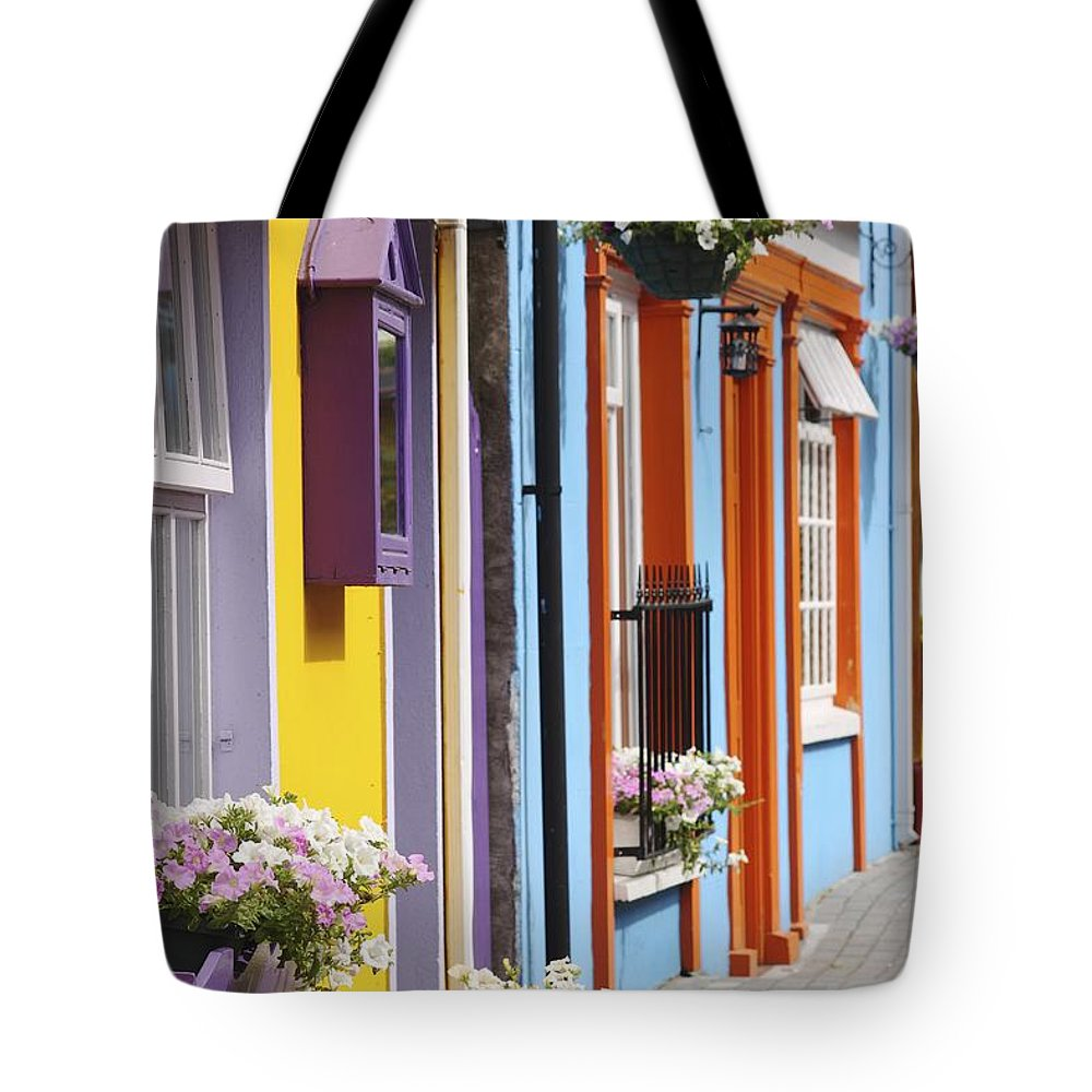 Buildings Tote Bag featuring the photograph Painted Buildings On Main Street In by Trish Punch
