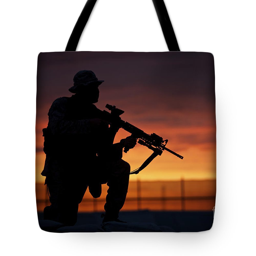 Marine Tote Bag featuring the photograph Silhouette Of A U.s Marine On A Bunker by Terry Moore