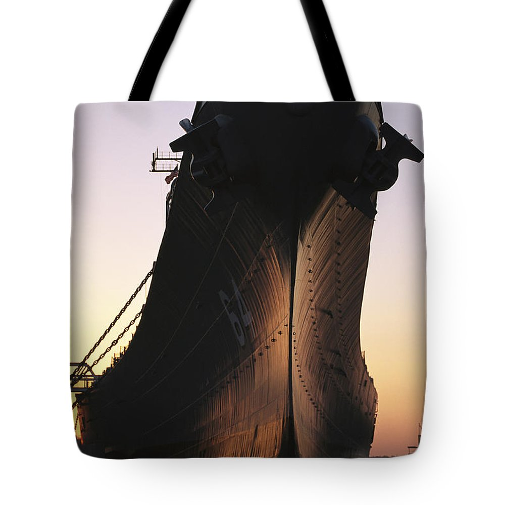 U.s.s. Wisconsin Tote Bag featuring the photograph Silhouette Of The Battleship U.s.s by O. Louis Mazzatenta