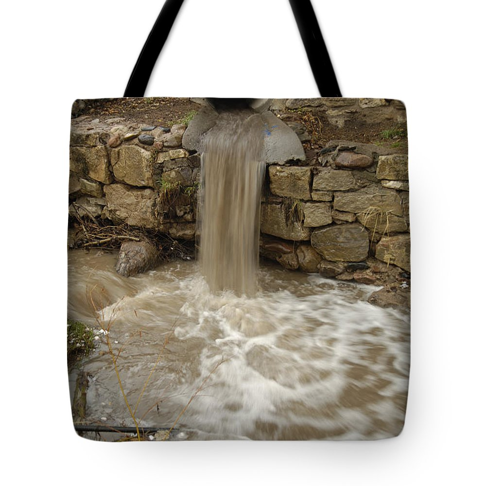 Photography Tote Bag featuring the photograph Storm Sewer Water Rushes Into A Stream by Joel Sartore