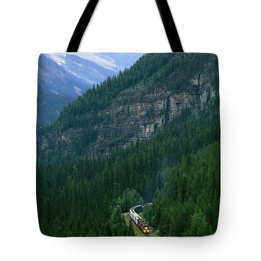North America Tote Bag featuring the photograph The Canada Pacific Train Travels by Michael Melford