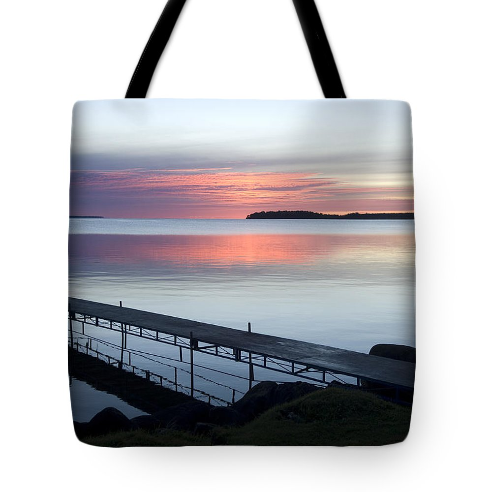 Walker Tote Bag featuring the photograph The Dock At Traders Bay Lodge On Leech by Joel Sartore