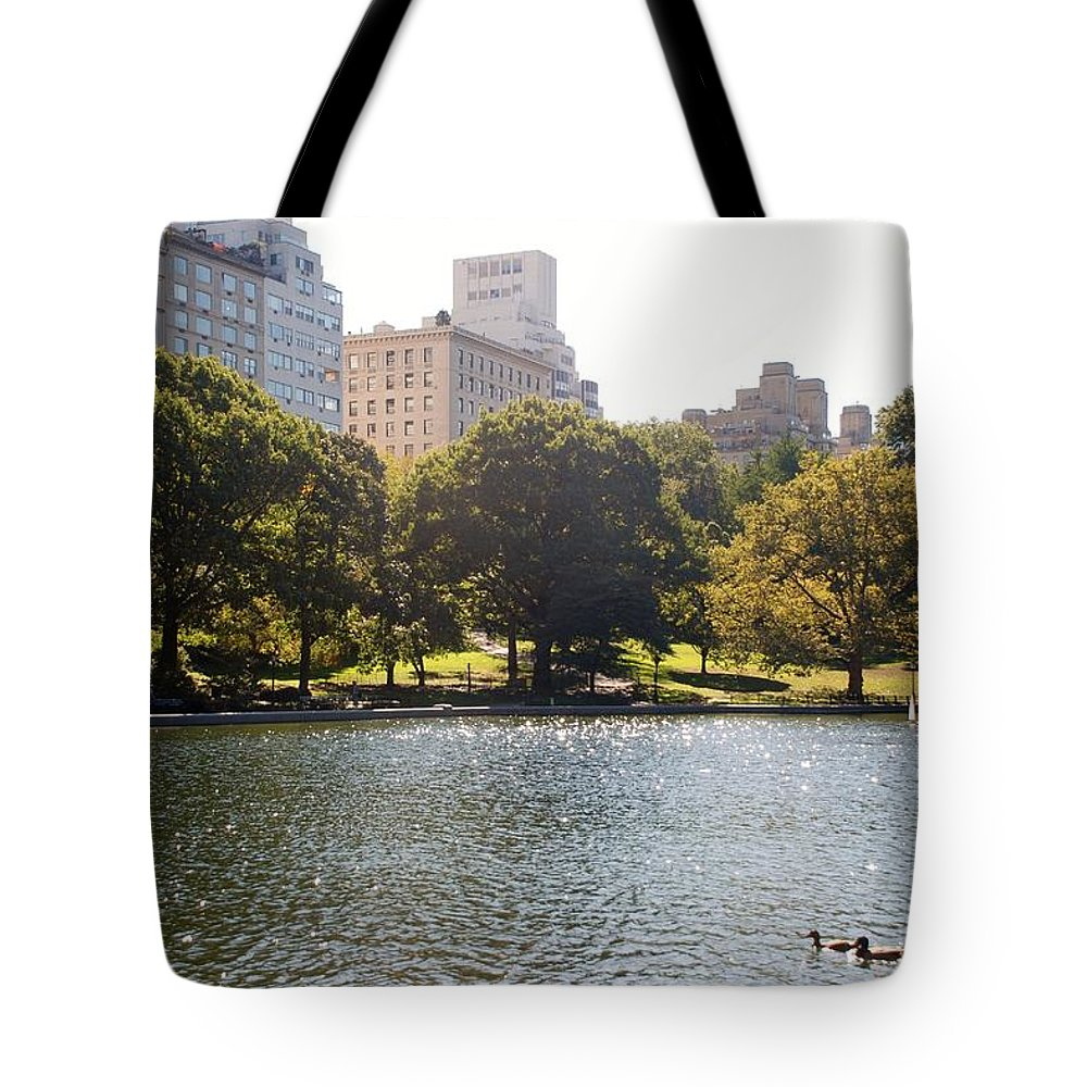 Central Park Tote Bag featuring the photograph Things On The Water by Rob Hans