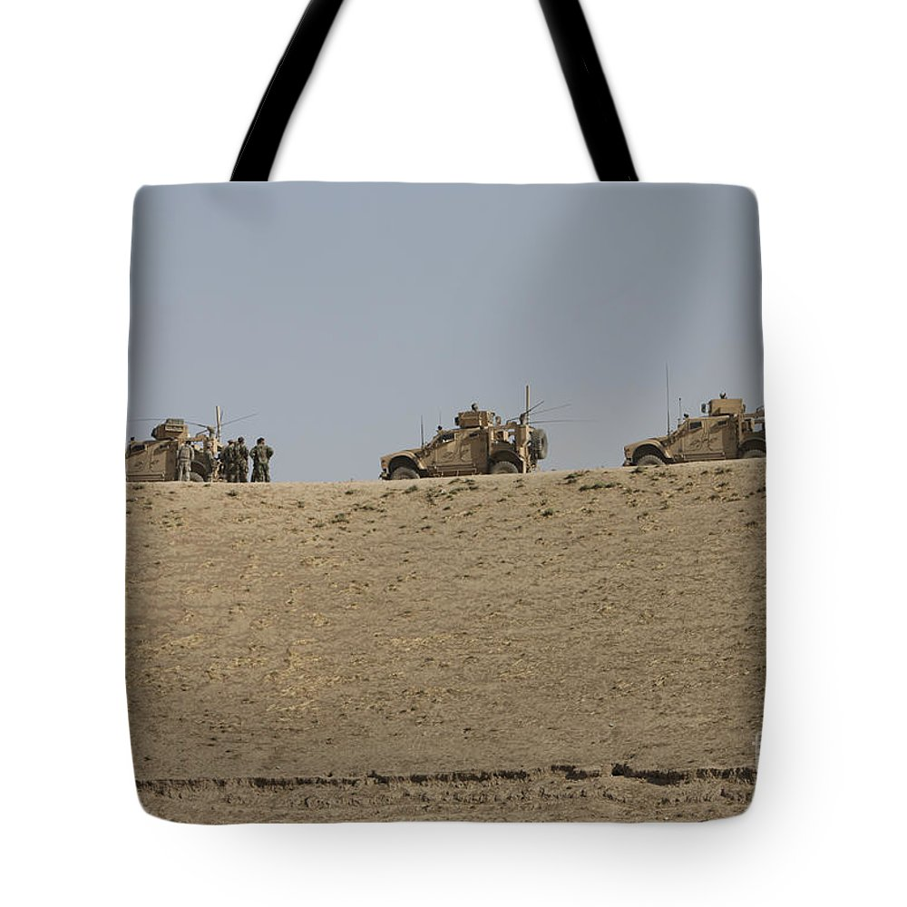 Armor Tote Bag featuring the photograph Three M-atvs Guard The Top Of The Wadi by Terry Moore