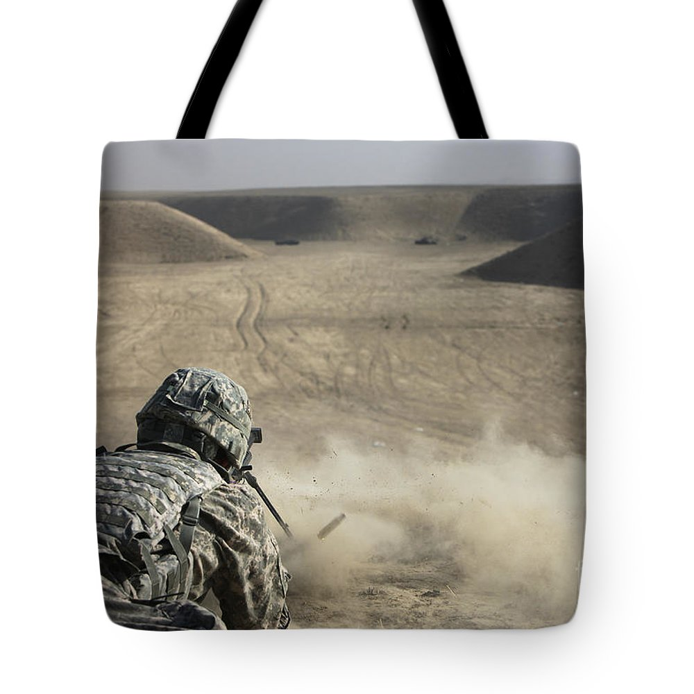 Operation Enduring Freedom Tote Bag featuring the photograph U.s. Army Soldier Fires A Barrett M82a1 by Terry Moore