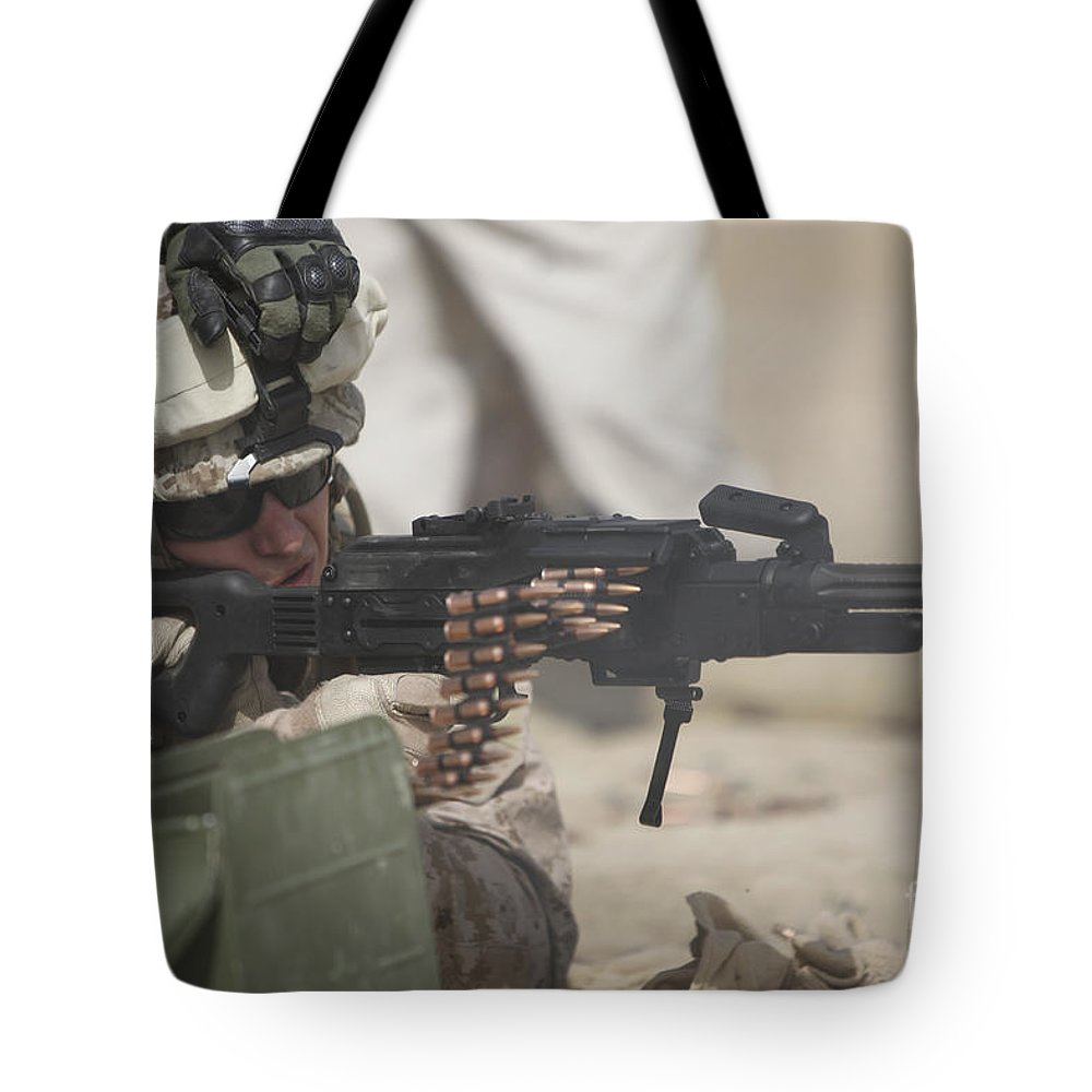 Sight Tote Bag featuring the photograph U.s. Marine Firing A Pk 7.62mm Machine by Terry Moore