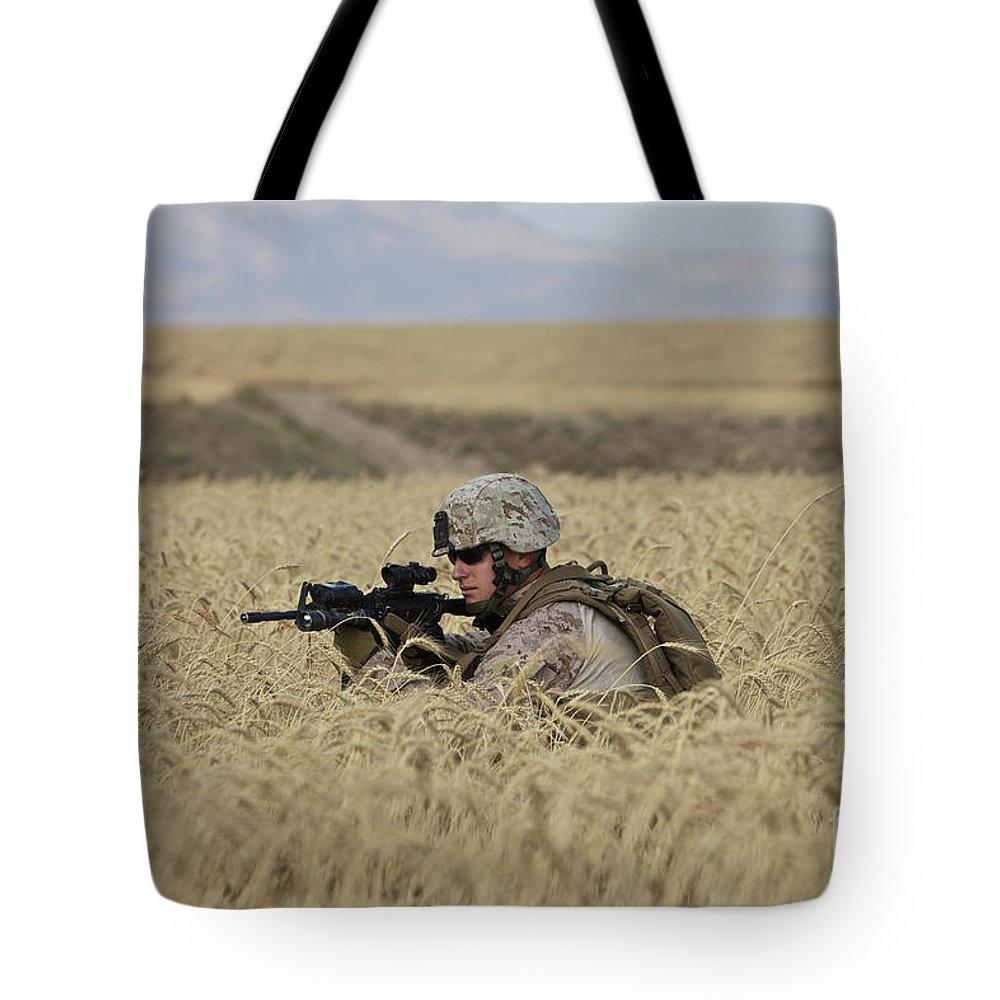 Field Tote Bag featuring the photograph U.s. Marine Patrols A Wadi Near Kunduz by Terry Moore