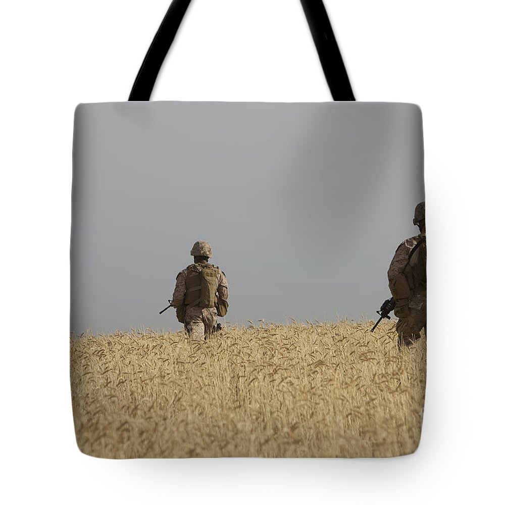Field Tote Bag featuring the photograph U.s. Marines Patrol A Wadi Near Kunduz by Terry Moore