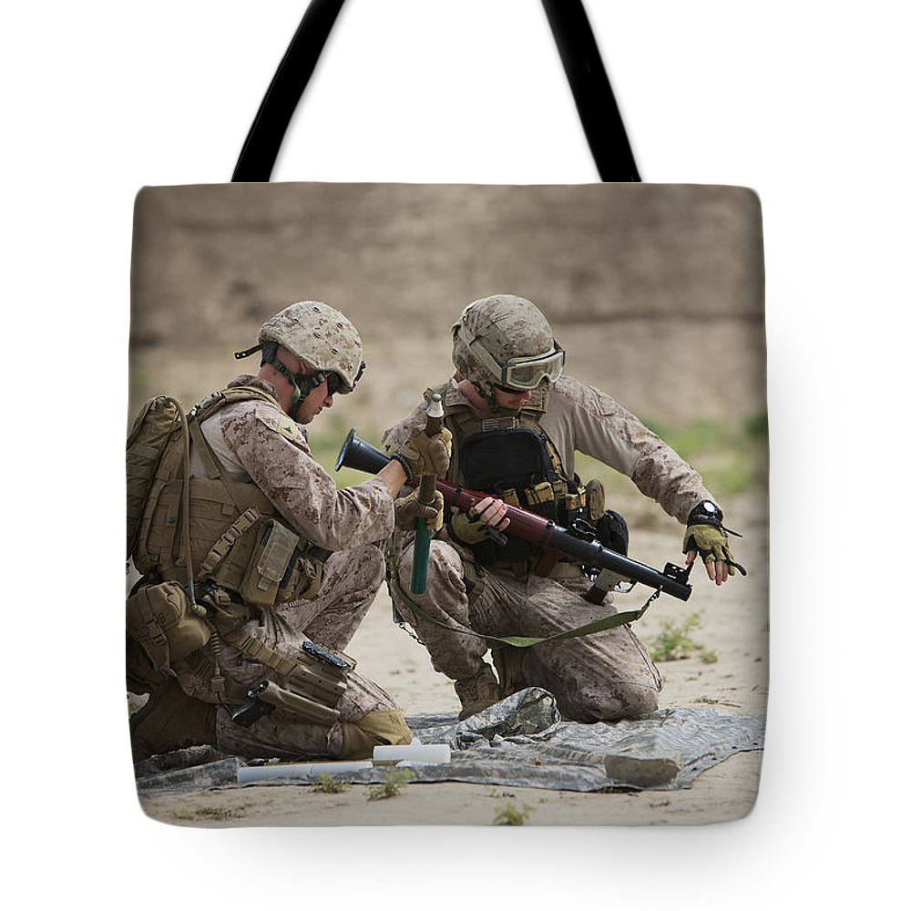 Kunduz Tote Bag featuring the photograph U.s. Marines Prepare A Fragmentation by Terry Moore