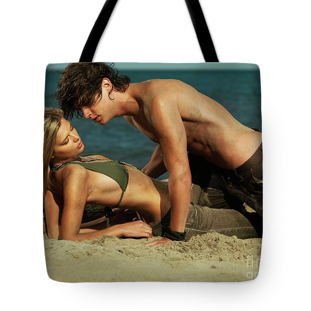 Love Tote Bag featuring the photograph Young Couple On The Beach by Oleksiy Maksymenko